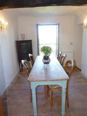 Alongside the kitchen is the dining table, that seats six to eight. The views of the lavender fields from the dining room leave you breathless.
