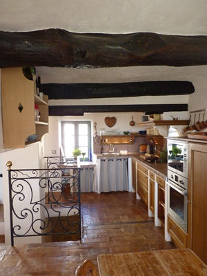Up a couple of stairs into the open plan kitchen and dining room. The Provençal kitchen has all modern utilities- oven, induction cooktop, dishwasher, microwave, nespresso machine etc decorated in Provençal style