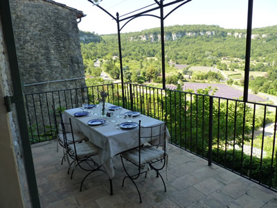 From the living room you enter the terrace through French doors. This is a favourite place for petite dejeuner, al fresco dining or aperitifs. The views of the lavender fields are stunning.